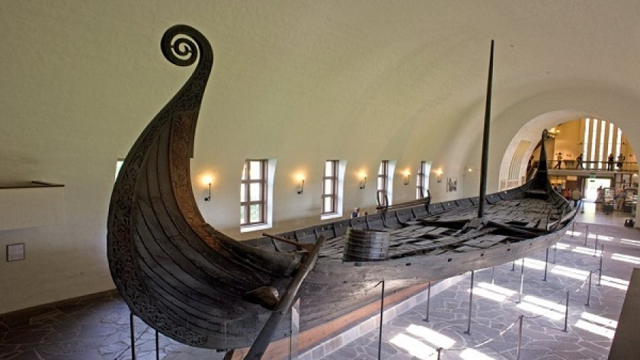 "Endless points of convergence between land and water in creative landscape paintings from within the ""Viking Ships"" museum in Norway"
