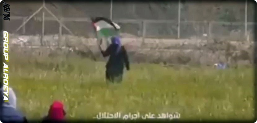 An Israeli soldier shoots a Palestinian woman