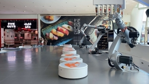 The customer can order what he wants from robots, made in Germany, which are prepared and other robots deliver it directly to the tables.
