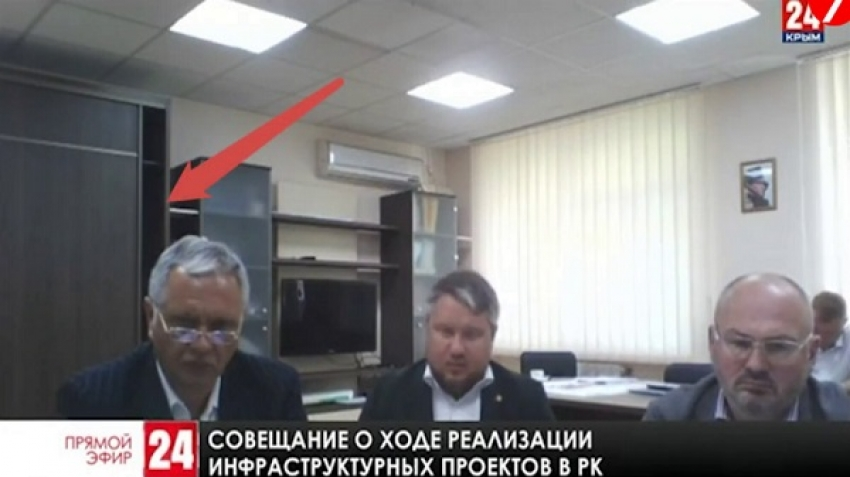 The secret behind a Russian official stepping out of a wardrobe during a meeting