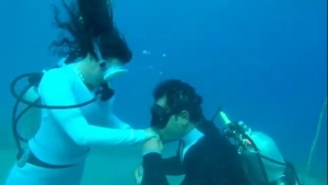 In the depths of the Egyptian waters of Dahab, two divers hold their engagement party